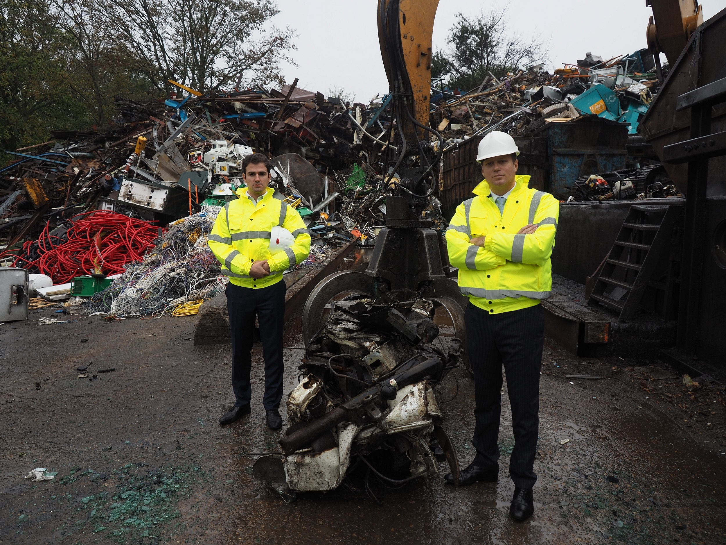 After: Councillor Roberto Weeden-Sanz (left), Chair of the Safer Communities Partnership Board, and Leader of Barnet Council, Councillor Dan Thomas, at the truck crushing