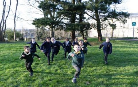 group of school children running