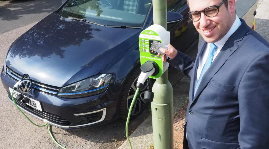 •	Councillor Dean Cohen, Chair of the Environment Committee, tests out one of Barnet's new charging points