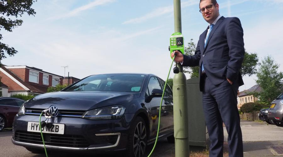 Councillor Dean Cohen, Chair of the Environment Committee, tests out one of our new charging points