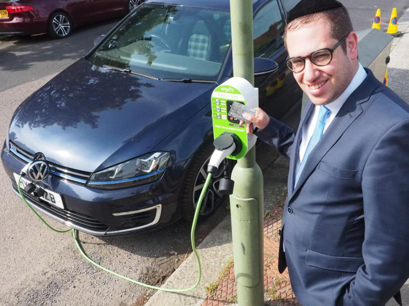 •	Councillor Dean Cohen, Chair of the Environment Committee, tests out one of our new charging points