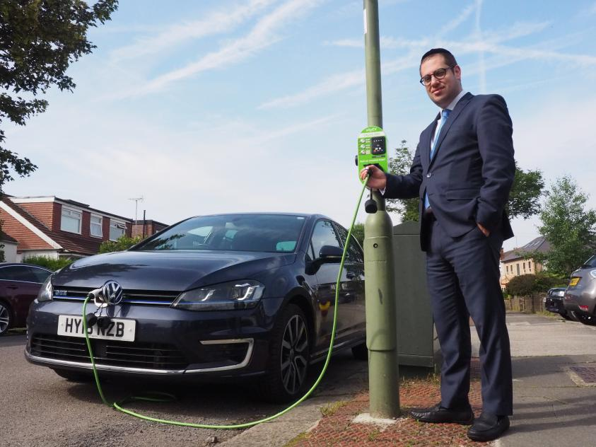 Councillor Dean Cohen, Chair of the Environment Committee, tests out one of our new charging points.