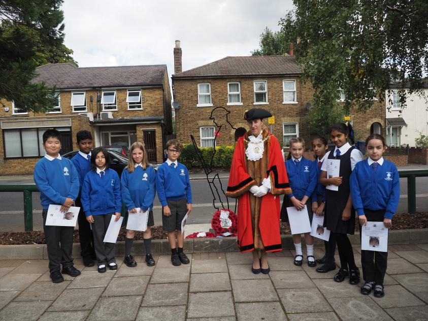 The Worshipful Mayor of Barnet, Councillor Caroline Stock, with children from Northside Primary School next to the new Lodge Lane Tommy sculpture in North Finchley.