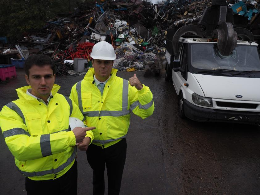 Before: Councillor Roberto Weeden-Sanz (left), Chair of the Safer Communities Partnership Board, and Leader of Barnet Council, Councillor Dan Thomas, at the truck crushing
