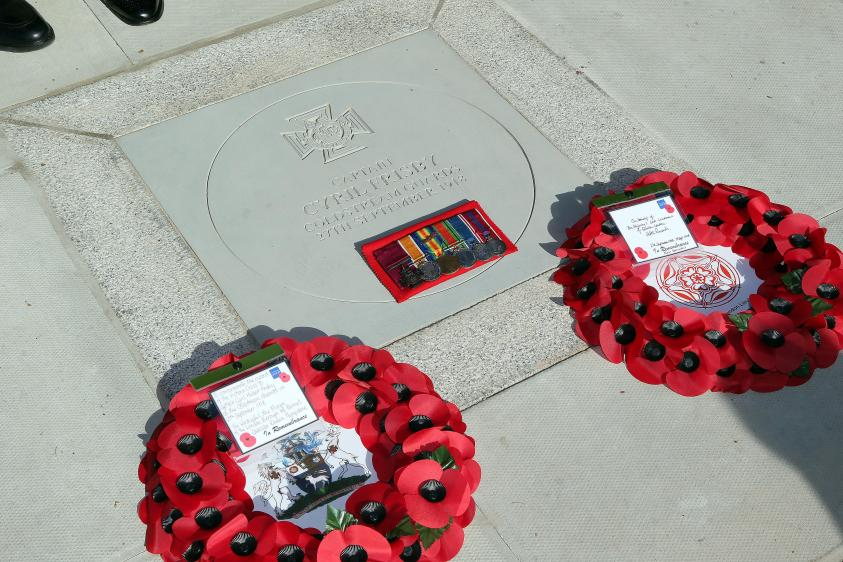 Paving stone tribute to Captain Cyril Hubert Frisby with poppy wreaths